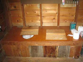 A picture of the inside of the outhouse at my family's cabin at Flathead Lake in Montana