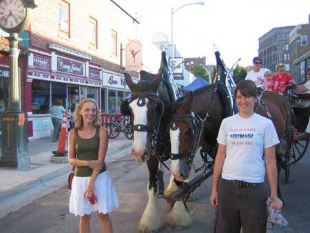 Jenn and I standing next to two giant horses